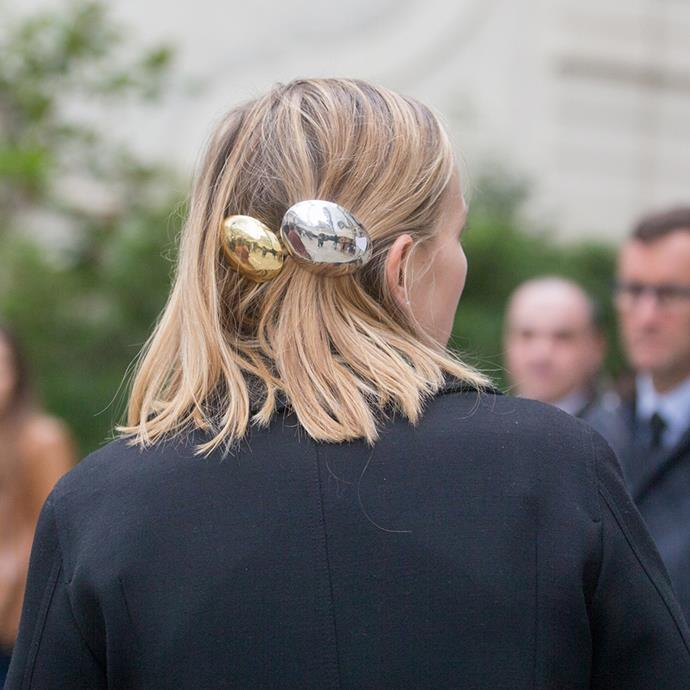 """***A chic pin***<br><br> """"Alighieri and Sophie Buhai are among the brands offering delicate, super-chic gold hair pins and clips,"""" says O'Neill, who advises picking something dainty to slide into low chignons or half-back 'dos."""