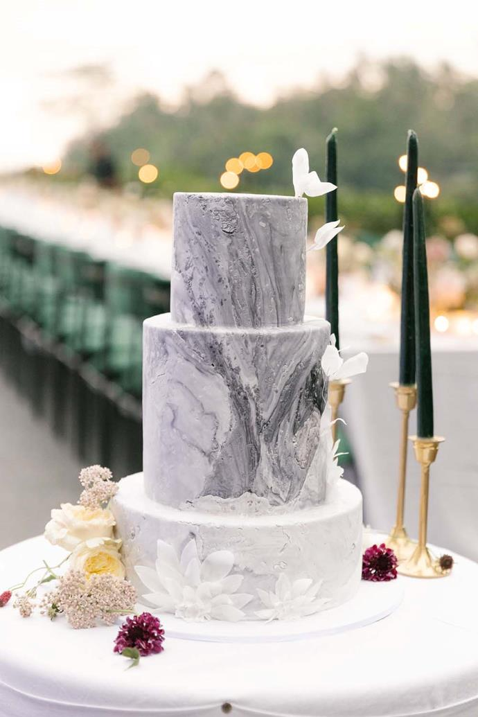 "**On the cake:** ""Choosing the cake was quite easy. We had an ombre cake in which you could taste vanilla, chocolate and lime all at once! The cake was three tiers; decorated to resemble blocks of marble, with sugar flowers that echoed the embroidered blooms on my Viktor & Rolf wedding dress."""