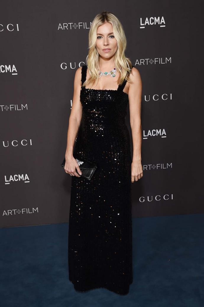 Sienna Miller wearing a Gucci necklace valued at over $724,000 AUD.