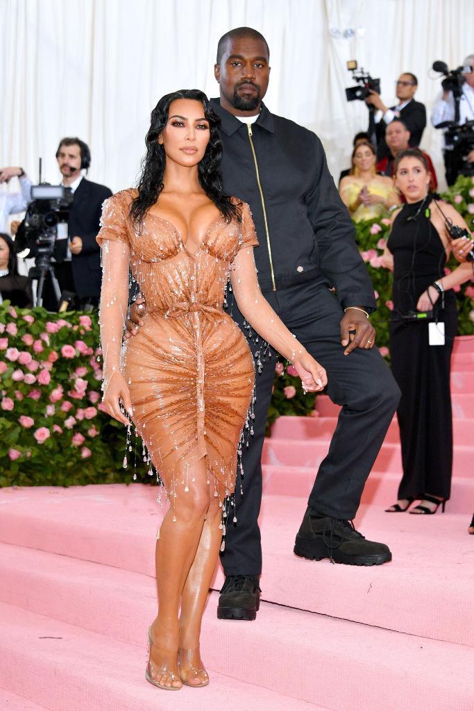 Kim Kardashian (wearing custom Thierry Mugler) with Kanye West at the 2019 Met Gala.
