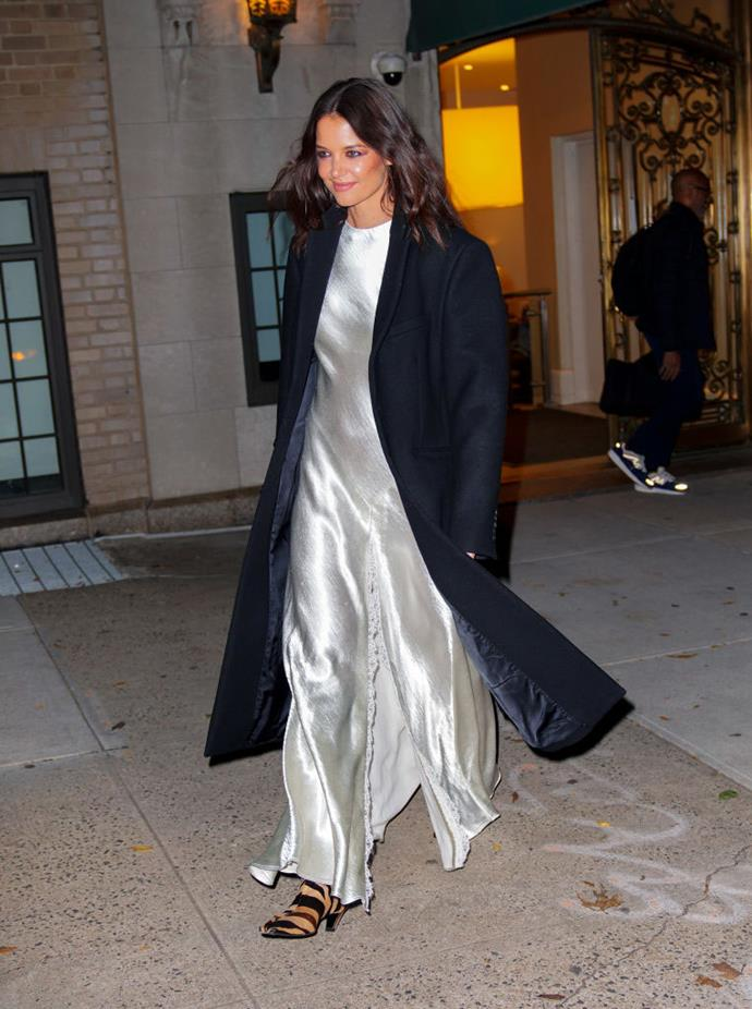 In a silver satin Philosophy di Lorenzo Serafini dress, with a Khaite trench coat, in New York on November 6, 2019.