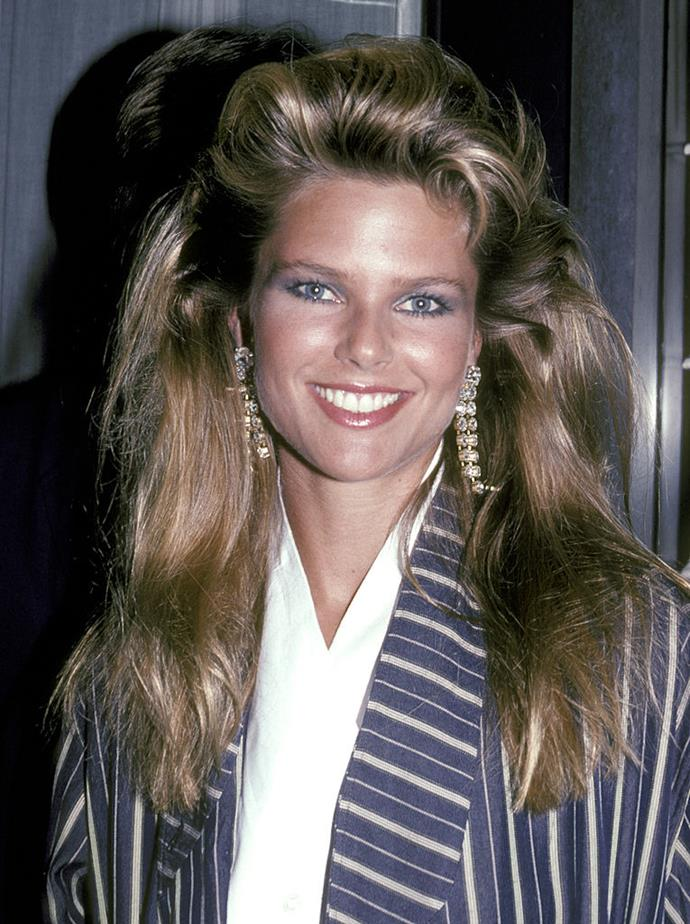 "**1983: Big hair**<br><br>  The saying ""The higher the hair, the closer to God"" took on new meaning in the early '80s, thanks to Christie Brinkley's voluminous roots."