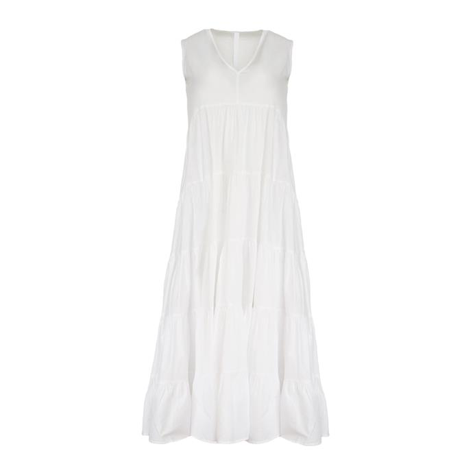 "Dress by Merlette, $550 at [The Undone](https://www.theundone.com/collections/dresses/products/santa-elena-dress-white|target=""_blank""