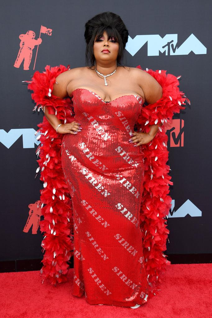 "**8. Lizzo**<br><br>  Arguably one of the biggest all-round stars of 2019, it's no surprise that Lizzo made it into the top 10 most powerful dressers list. Thanks to the ""Good As Hell"" singer, Lyst noted a number of crescendos in specific item-based searches, including the red metallic off-shoulder gown she wore to the MTV VMAs and a 28% boost in searches for 'leotards' (Lizzo's onstage costume of choice)."