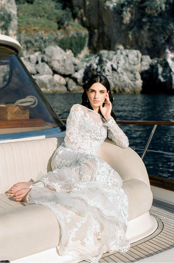 "**On the entertainment:** We rented a ""Gozzo"" (a traditional Italian boat) to toast to our elopement. We took a ride, looking at the amazing view you can have from the sea, from Casa Privata to Positano."