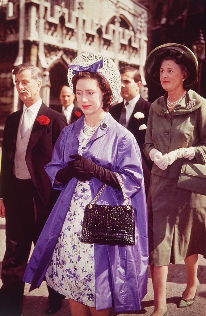 Radiant in a purple opera coat in 1962.