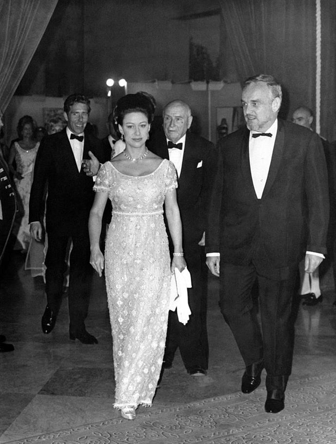 In an empire-waist column gown in 1966.