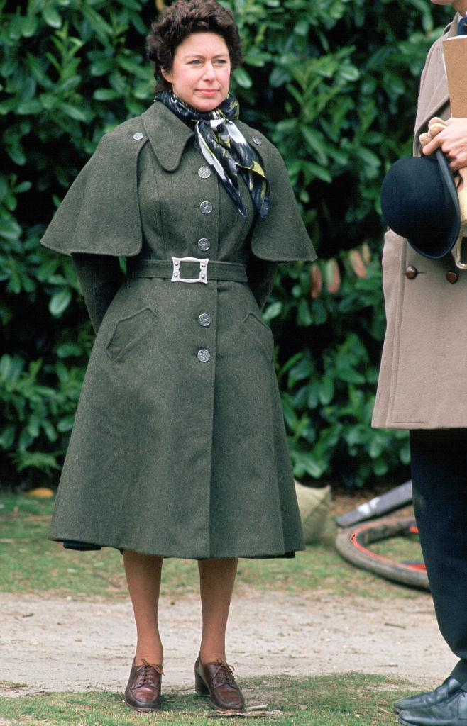 In a forest green trench coat in 1975.