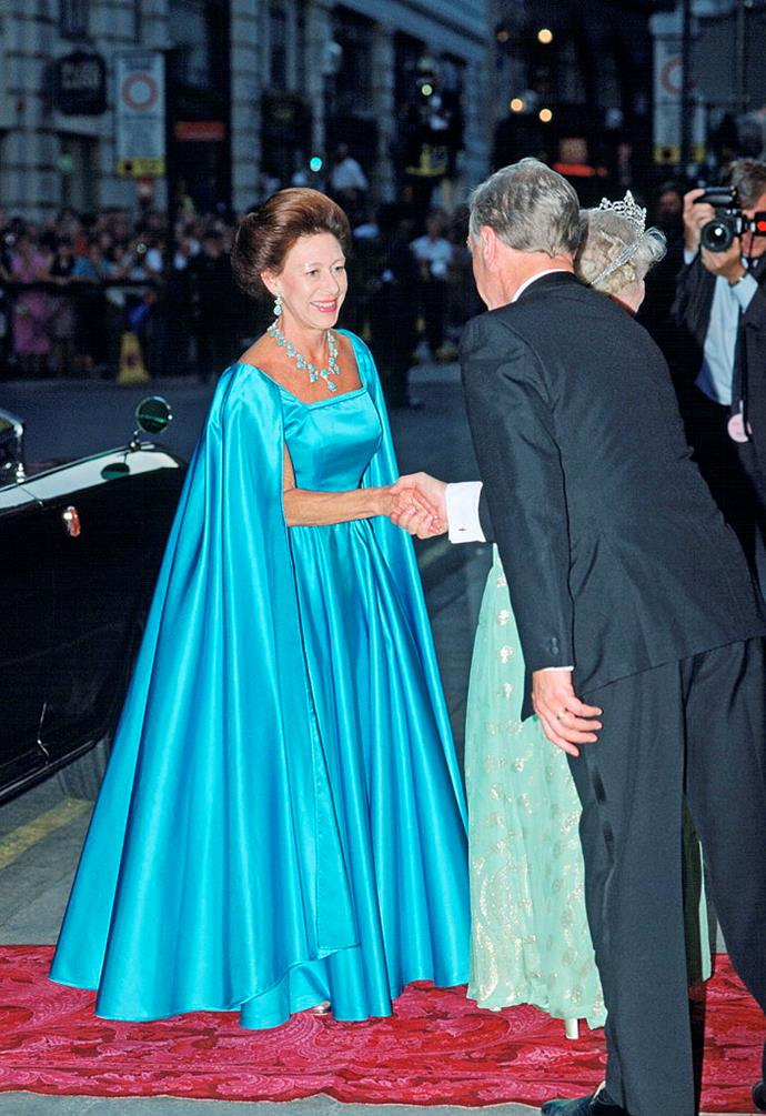 In aqua blue attending the Queen Mother's 90th birthday in 1990.