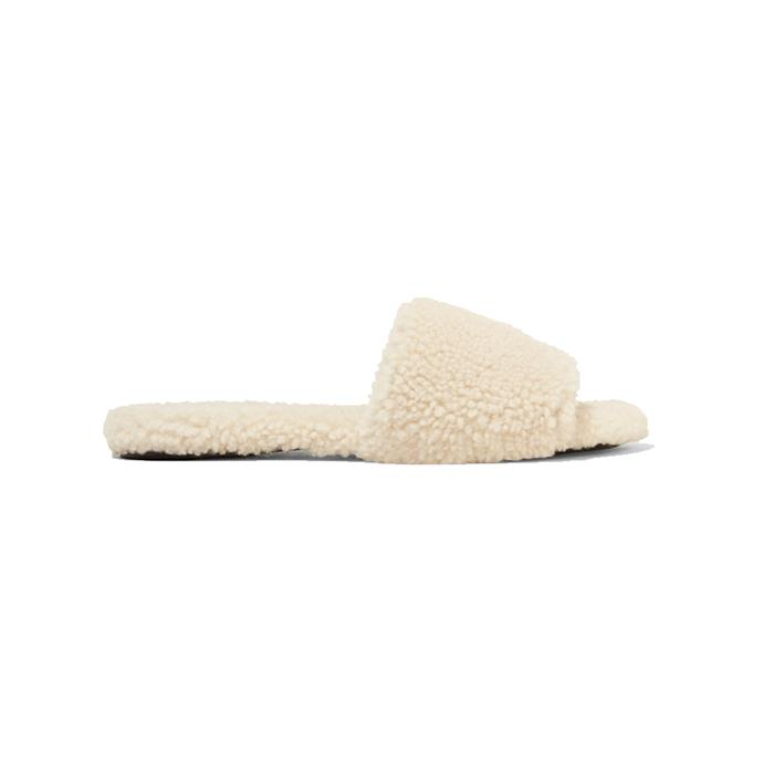 """Shearling slippers by The Row, $1,388 at [NET-A-PORTER](https://www.net-a-porter.com/au/en/product/1058543/The_Row/teddy-bear-shearling-slides target=""""_blank"""" rel=""""nofollow"""")."""
