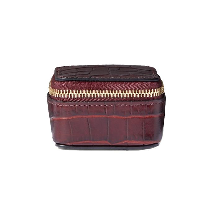 """Pouch by Smythson, $240 at [NET-A-PORTER.](https://www.net-a-porter.com/au/en/product/1212524/Smythson/mara-glossed-croc-effect-leather-pouch target=""""_blank"""" rel=""""nofollow"""")"""