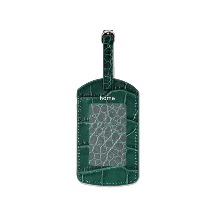 """Luggage tag, $40 by [Pop & Suki](https://popandsuki.com/products/travel-luggage-tag target=""""_blank"""" rel=""""nofollow"""")."""