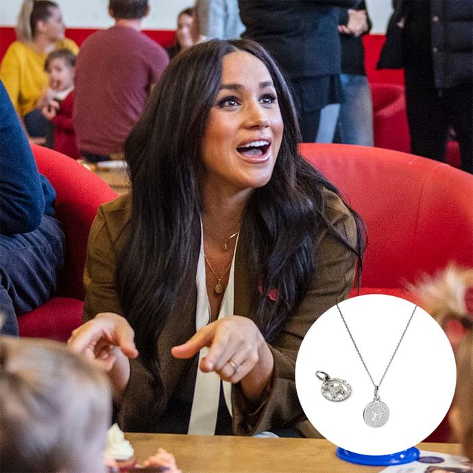 "During a visit to the Broom Farm Community Centre in Windsor, Meghan was spotted wearing Suetables' ""Shirley Zodiac"" Virgo pendant for Harry and the ""Vanessa Coin Zodiac"" Taurus necklace for Archie."