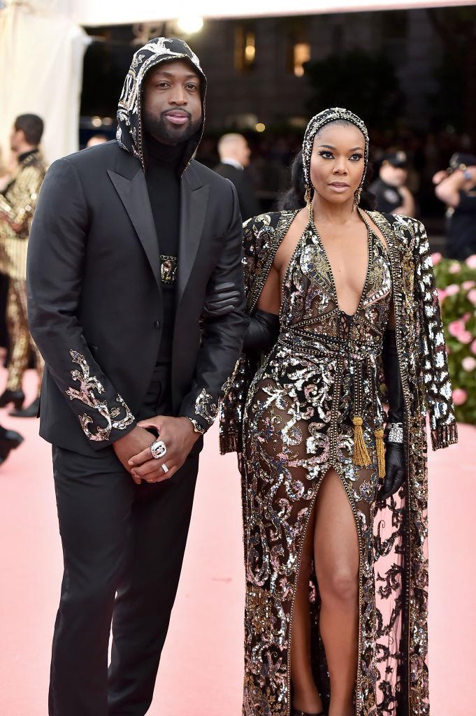 Gabrielle Union and Dwyane Wade his'n'hers Met Gala looks in 2019.