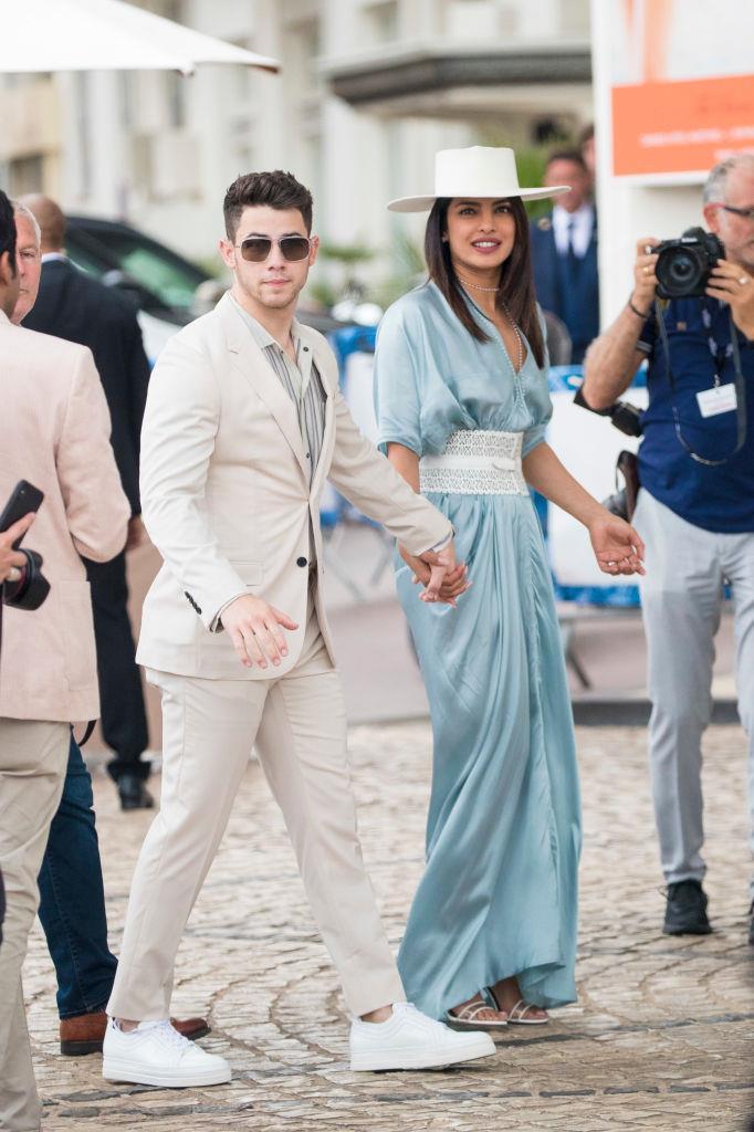 Priyanka Chopra and Nick Jonas' blue-meets-ecru outfits in 2019.