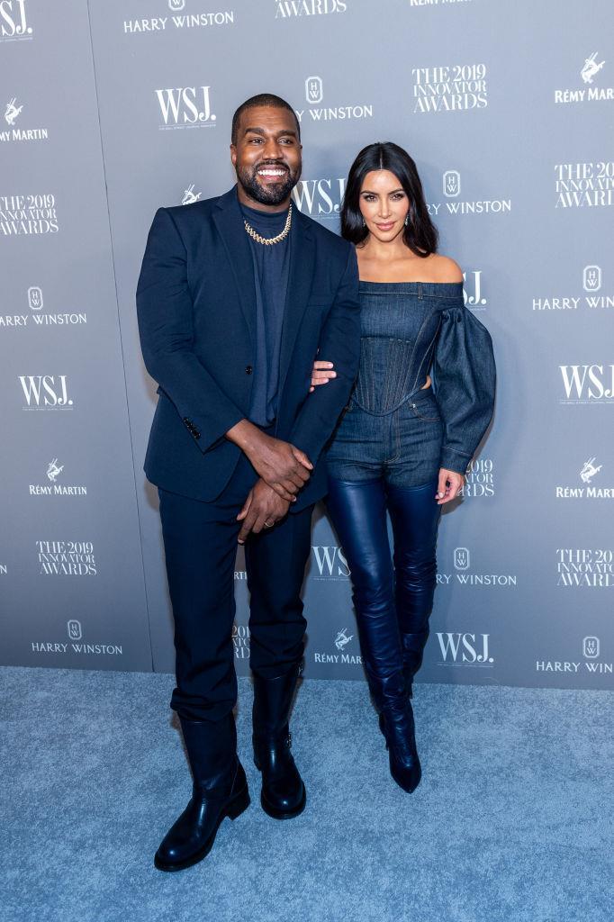 Kim Kardashian and Kanye West's deep navy tailoring in 2019.