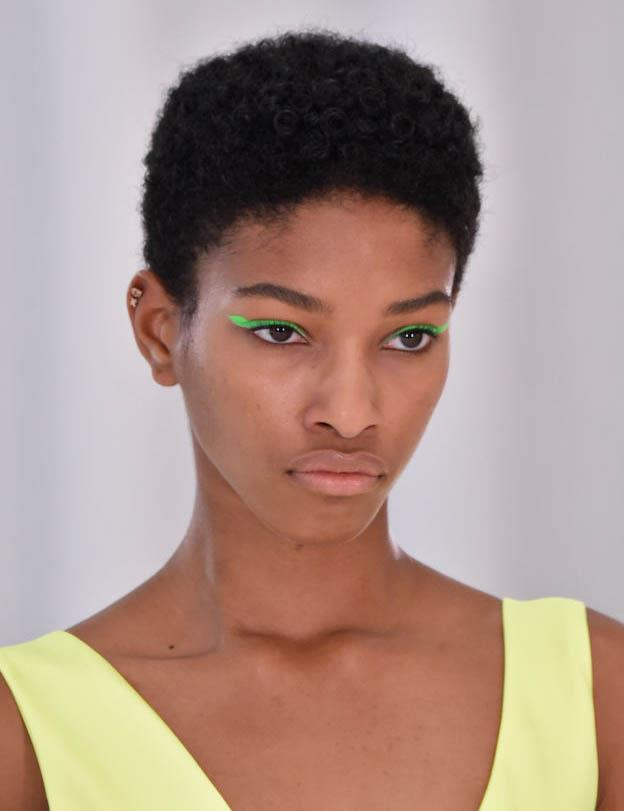 **SIXTIES-STYLE NEON EYELINER**<br><br>  Running parallel to the *Euphoria* effect, '60s-style winged eyeliner made a neon splash on the spring/summer 2020 runways, appearing in the shows of Helmut Lang (pictured here), Versace and Nicole Miller, among others.