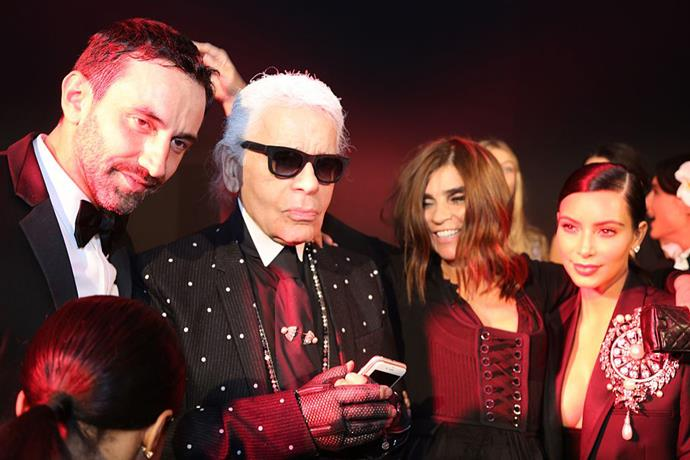 Kim Kardashian West with Riccardo Tisci, Karl Lagerfeld and Carine Roitfeld in September 2014.