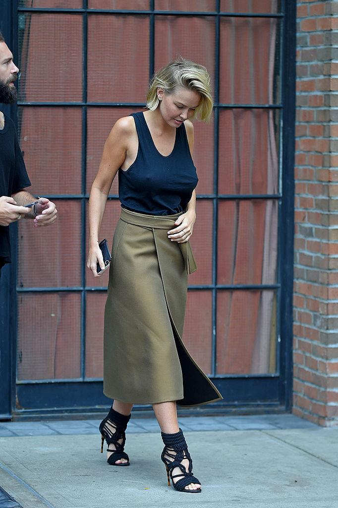 **A Wrap Skirt** <br><br> Khaki is equally as flattering as black, but with a little more visual intrigue.
