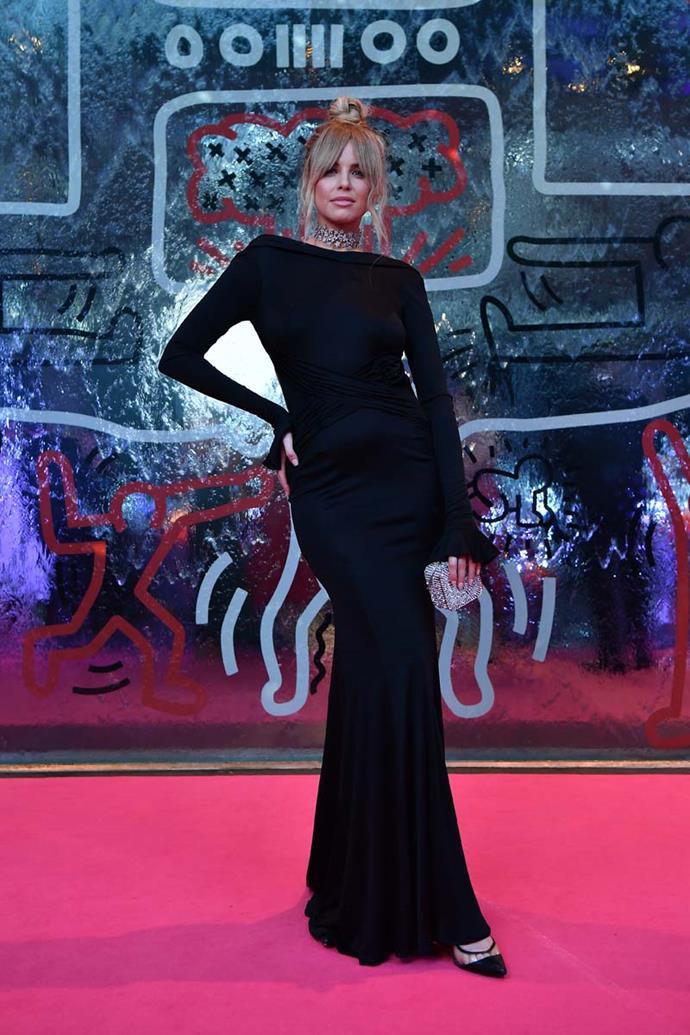 Tegan Martin, in Oglialoro Couture.