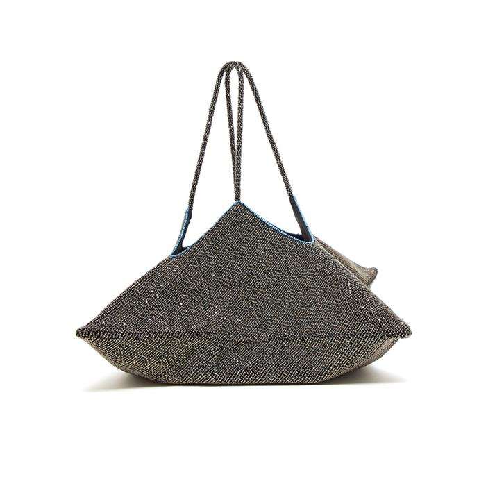 "Bag by The Row, $4,775 at [MATCHESFASHION.COM.](https://www.matchesfashion.com/au/products/The-Row-Flat-Hobo-beaded-geometric-clutch-1305593|target=""_blank""