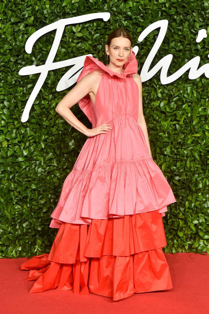 "**Roksanda Ilinčić in Roksanda** <br><br> ""The tiered dress of my dreams!"" — *Samantha Wong, Market Editor* <br><br> ""Red and pink always has that frisson of surprise: this actually *works*, like peaches and balsamic. Ditto the frillneck-style drama up top with her low-key hair and simple red lip. What's the word? Assured."" — *Tom Lazarus, Copy Director*"