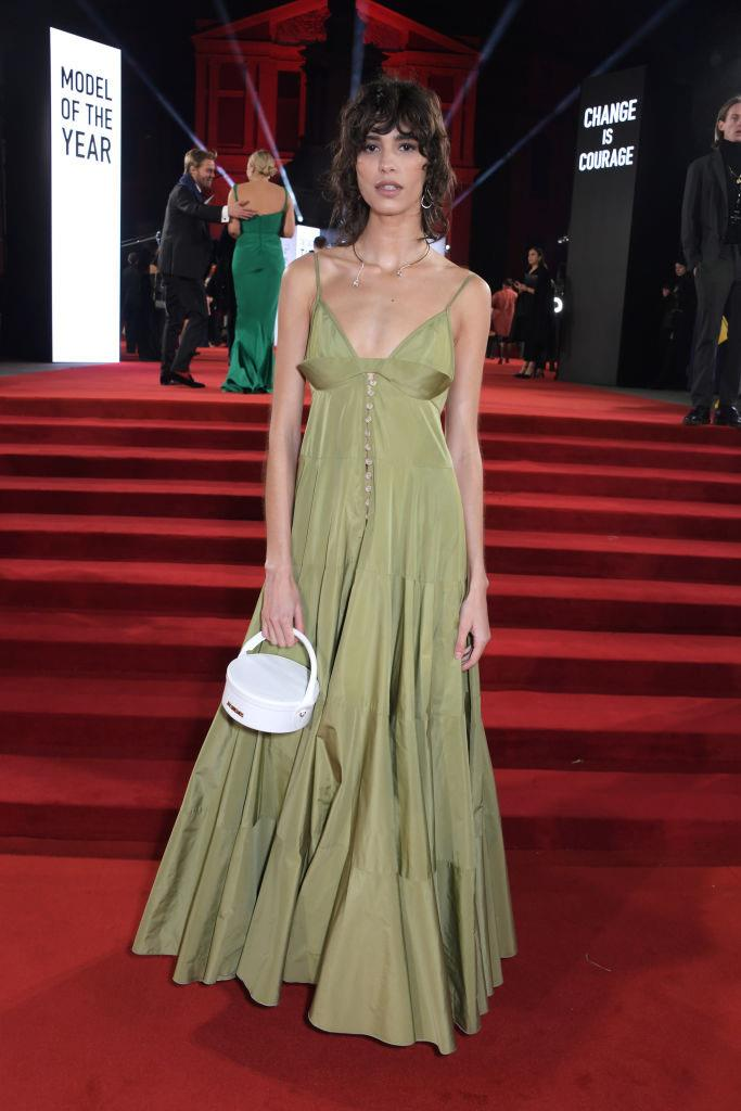 "**Mica Argañaraz in Jacquemus** <br><br> ""The borderline-sludgy shade of this dress and its homespun shape would be a gamble on any red carpet, but Mica is making it work, big time. Like a quality biscotti, it draws its power from the frothy creations beside it. (Side note: is that a necklace, or is she planning to catch up on podcasts when the speeches get boring? Either way, it's a perfect finishing touch.)"" — *Tom Lazarus, Copy Director* <br><br> ""This was one of my favourite looks from the Jacquemus show. It is so effortless yet impactful."" — *Caroline Tran, Fashion Editor*"