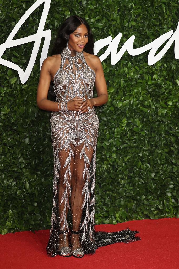 "**Naomi Campbell in Alexander McQueen** <br><br> ""I love Naomi in this Alexander McQueen dress. The contrast of the heavy beading and sheer fabric is incredible."" — *Caroline Tran, Fashion Editor*"