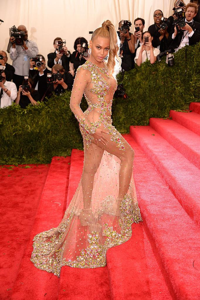 **Beyoncé in Givenchy by Riccardo Tisci at the Met Gala (2015)** <br><br> Though she arrived two hours late to the 2015 Met Gala, Beyoncé's see-through Givenchy gown made sure she was the star of the night. With its intricate embroidery featuring priceless Lorraine Schwartz jewels, this look was another example of a naked dress gone right.