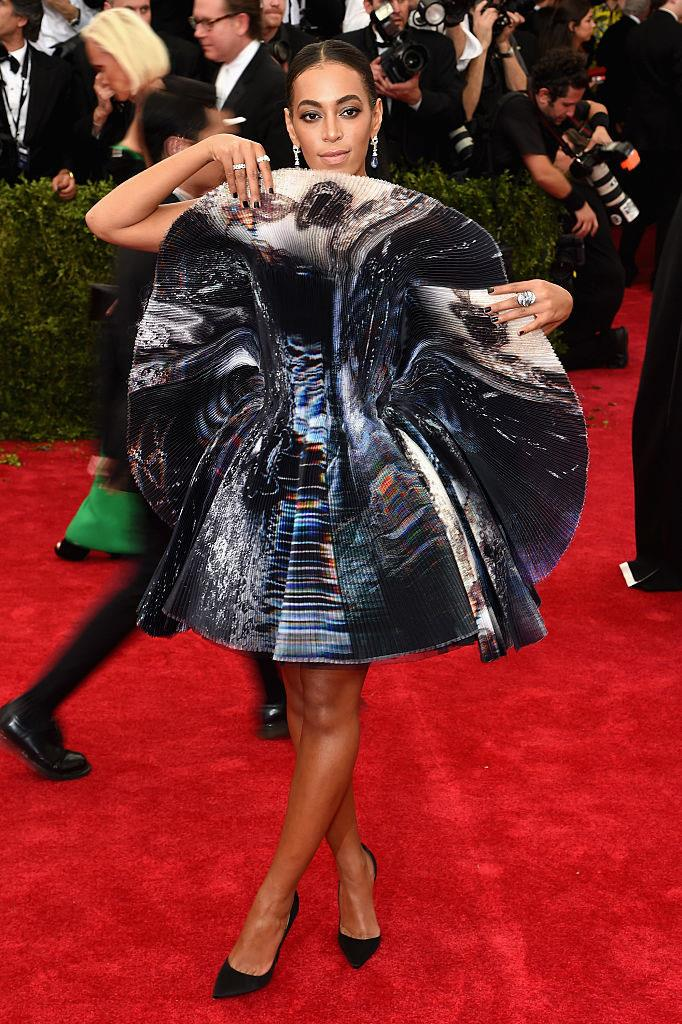 **Solange in Giles Deacon at the Met Gala (2015)** <br><br> Solange's iridescent-effect Giles Deacon dress at the 2015 Met could be interpreted two different ways. It could be seen as simply a major red carpet statement, but also as a symbolic defence from the paparazzi, after an incident between the singer and her brother-in-law, Jay-Z, was captured and went viral on the Internet following the previous year's gala. Either way, we'll never forget this look.