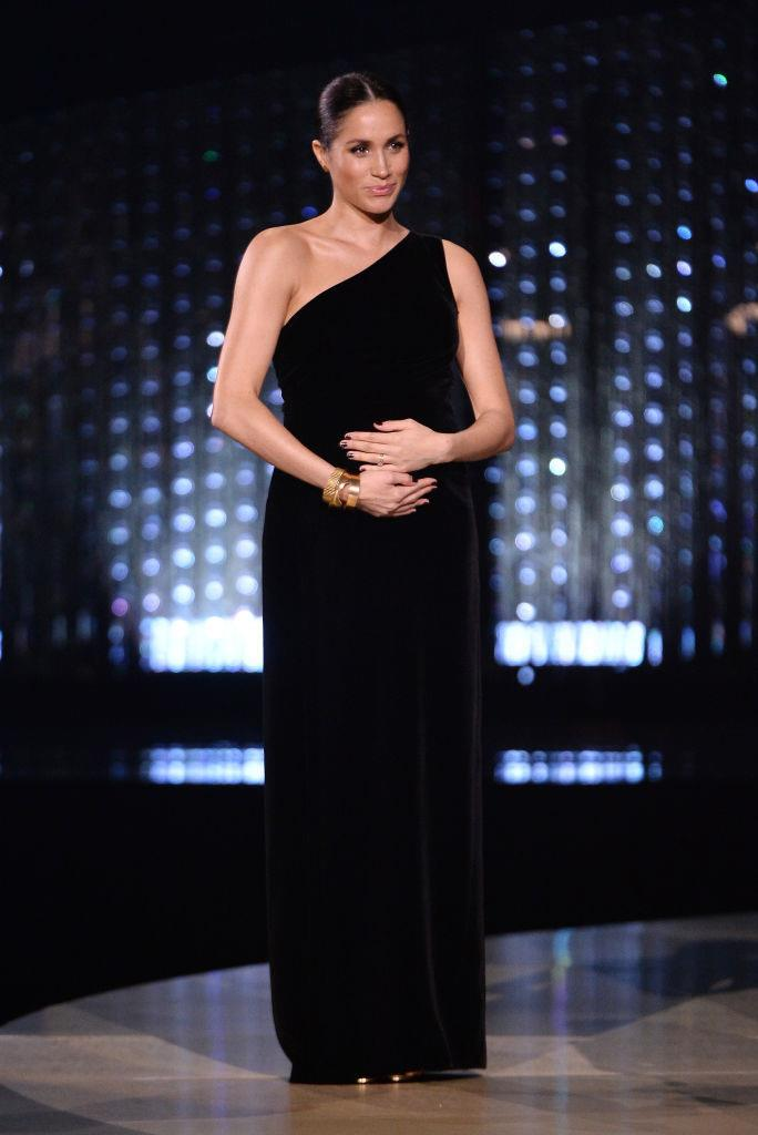 **Meghan Markle, the Duchess of Sussex in Givenchy at the British Fashion Awards (2018)** <br><br> Duchess Meghan skipped the red carpet and made a surprise appearance at the 2018 BFAs, to present an award to her wedding dress designer, Givenchy creative director Clare Waight Keller. The unexpected appearance had the entire world talking—as did Meghan's one-shoulder Givenchy gown, which saw her singlehandedly modernise the strict sartorial expectations placed on royal women.