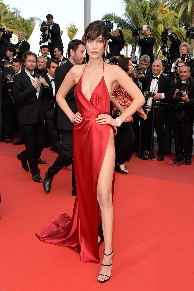 **Bella Hadid in Alexandre Vauthier at the Cannes Film Festival (2016)** <br><br> French couturier Alexandre Vauthier is known for his dramatic, often risqué designs, but the red dress he designed for Bella Hadid's Cannes appearance in 2016 was next level. Featuring a split so high it ended above her hipbone, Hadid had to navigate the red carpet carefully in order to avoid a (very possible) wardrobe malfunction.