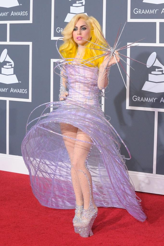 **Lady Gaga in Armani Privé at the Grammy Awards (2010)** <br><br> At the 2010 Grammys, Lady Gaga shocked and wowed onlookers in this whimsical custom creation by Armani Privé. The singer, who was nominated for six awards on the night, wore a pair of gravity-defying heels, and her yellow hair made for a striking contrast.