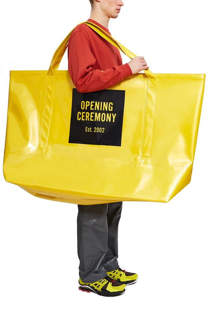 """**Opening Ceremony's giant yellow tote (2019)** <br><br> In 2019, New York label Opening Ceremony released the crème de la crème of giant handbags—a yellow, giant tote bag, which has, unsurprisingly, gone viral on social media (in a video that can be seen below). It currently retails on the [Opening Ceremony website](https://www.openingceremony.com/mens/opening-ceremony/super-large-tote-ST224778.html