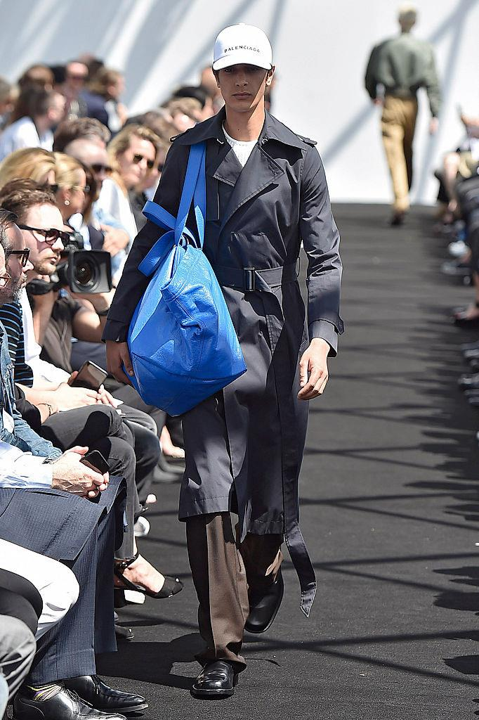 **Balenciaga's IKEA tote (2017)** <br><br> At their spring/summer '17 menswear show, Balenciaga also introduced a now-beloved spoof of IKEA's popular blue shopping tote—except, their one was made from calfskin, and retailed for over $2,000. <br><br> *Image: Getty*
