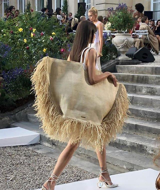 """**Jacquemus' straw totes (2018)** <br><br> French label Jacquemus produced giant variations of their popular straw tote bags in 2018, which were an instant success—and became the perfect accompaniment to their signature [straw sunhats](https://www.harpersbazaar.com.au/fashion/jacquemus-diet-prada-fight-16857
