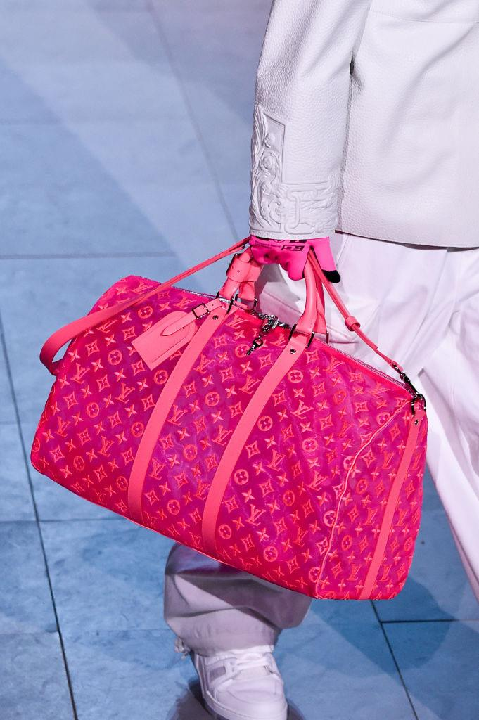 **Louis Vuitton's holographic travel bags (2019)** <br><br> There's no shortage of neon in Virgil Abloh's street-ready Louis Vuitton collections, and many of the exclusive pieces immediately become collector's items. While the neon 'Keepall' bags are intended for travel, it's not unlikely to see fashion influencers re-purposing them as trendy (albeit thoroughly oversized) handbags. <br><br> *Image: Getty*