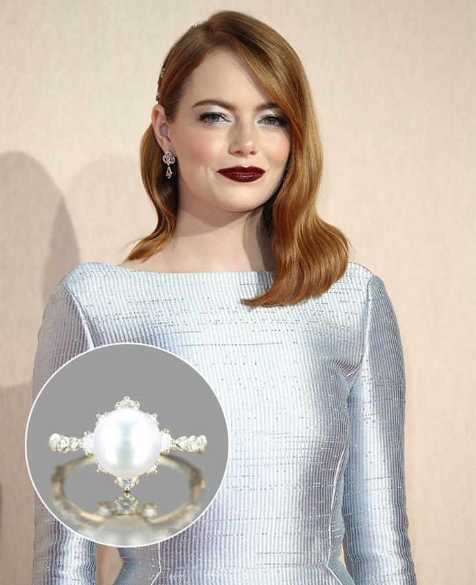 "[Emma Stone's engagement ring](https://www.harpersbazaar.com.au/bazaar-bride/emma-stone-engagement-ring-details-19695|target=""_blank"") from Dave McCary features a 8mm untreated Akoya pearl surrounded by .37 carat of diamonds set in 'beige gold.'"