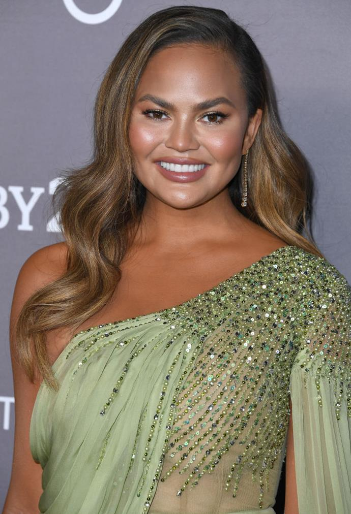 "**Chrissy Teigen**<br><br>  Although it mightn't be visible in most photos, Chrissy Teigen expressed her amusement towards discovering a patch of grey hair on Twitter in January 2018.<br><br>  ""I have a skunk like streak of grey hair and I'm actually very into it. My Cruella dreams are coming true,"" she [wrote](https://twitter.com/chrissyteigen/status/955469461590458368