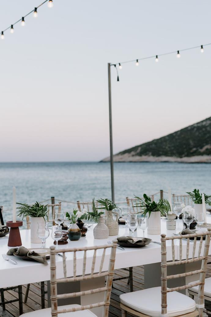 **On the food and drink:** The couple insisted on a local cuisine and décor for the tables from around the area in Greece.