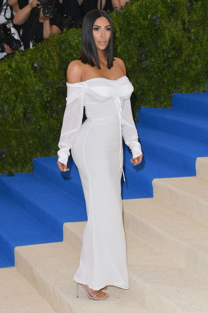 ***Kim Kardashian West: Now*** <br><br> The picture of KKW above (wearing Vivienne Westwood at the Met Gala) is from 2017, but it perfectly embodies the sleek, minimal and clean-cut aesthetic that's now become her signature—even if she occasionally breaks it up with a revealing look from the likes of Thierry Mugler, Versace, or Yeezy.