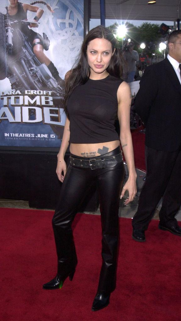 "***Angelina Jolie: Then*** <br><br> In the earliest days of her career, Angelina Jolie's red carpet style was monochromatic and tomboyish, with the self-confessed ""bad girl"" favouring androgynous outfits, accessories and beauty looks."