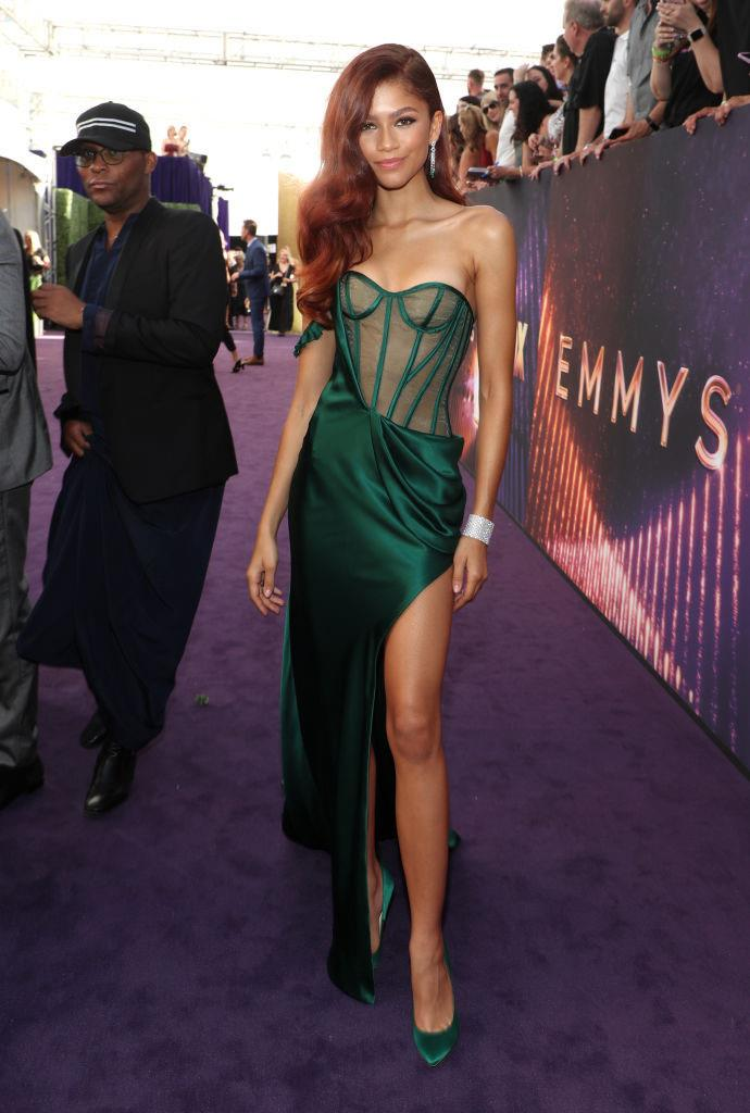 ***Zendaya: Now*** <br><br> Nowdays, it would be a fair to rank Zendaya among fashion's reigning It-girls. The *Euphoria* star works closely with her stylist, Law Roach, to produce an array of showstopping looks (pictured here in a custom dress by Vera Wang at the 2019 Emmy Awards).