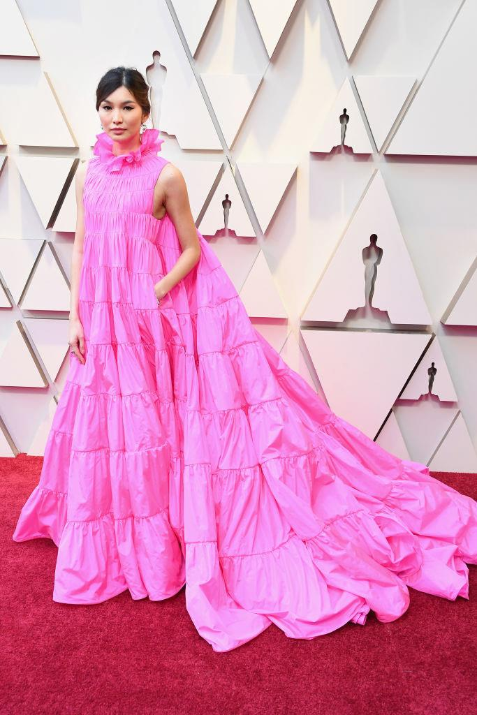 ***Gemma Chan: Now*** <br><br> Since the release of *Crazy Rich Asians*, Chan has become known for her exuberant, experimental red carpet style. Perhaps most notably, she wore this Valentino Couture confection to the 2019 Academy Awards, later admitting that she stored cookies inside its voluminous pockets.