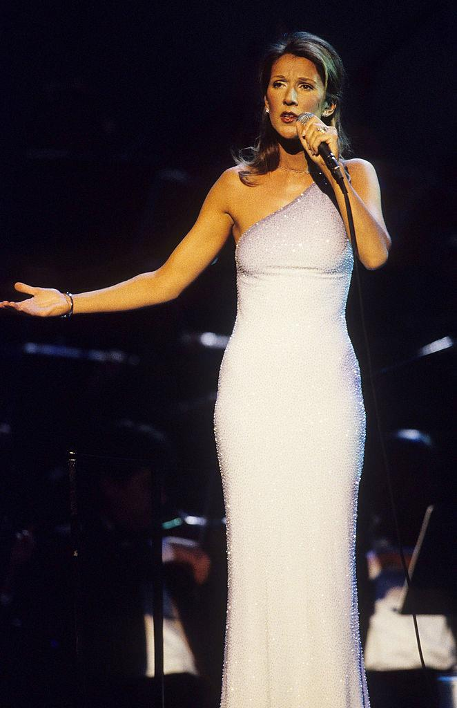 "***Celine Dion: Then*** <br><br> Around the time Celine Dion attained global success for her song ""My Heart Will Go On"", her style was elegant, graceful, and worthy of a chart-topping diva (pictured here in 1998)."