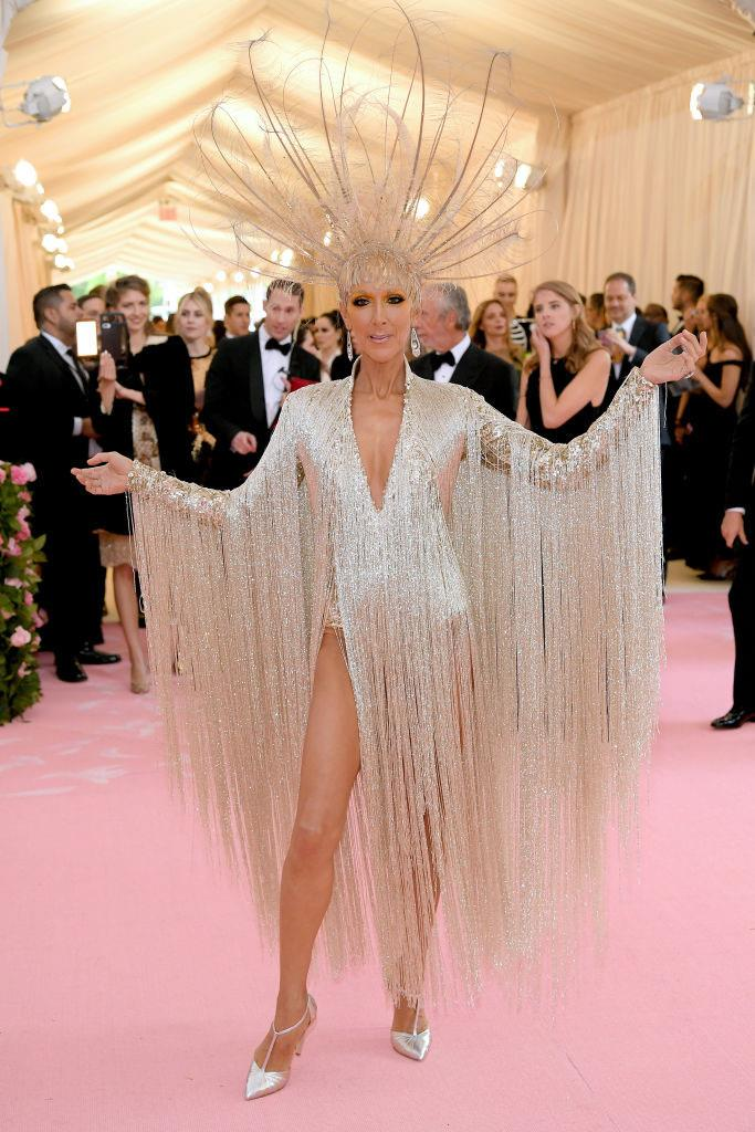 "***Celine Dion: Now*** <br><br> By 2019, Celine Dion's style is almost as enlightening as her voice is—from her unforgettable sequinned Oscar de la Renta ensemble at the 2019 Met Gala (pictured), to the delightfully meta [*Titanic* hoodie](https://www.hollywoodreporter.com/news/celine-dion-her-titanic-sweatshirt-by-vetements-986830|target=""_blank""