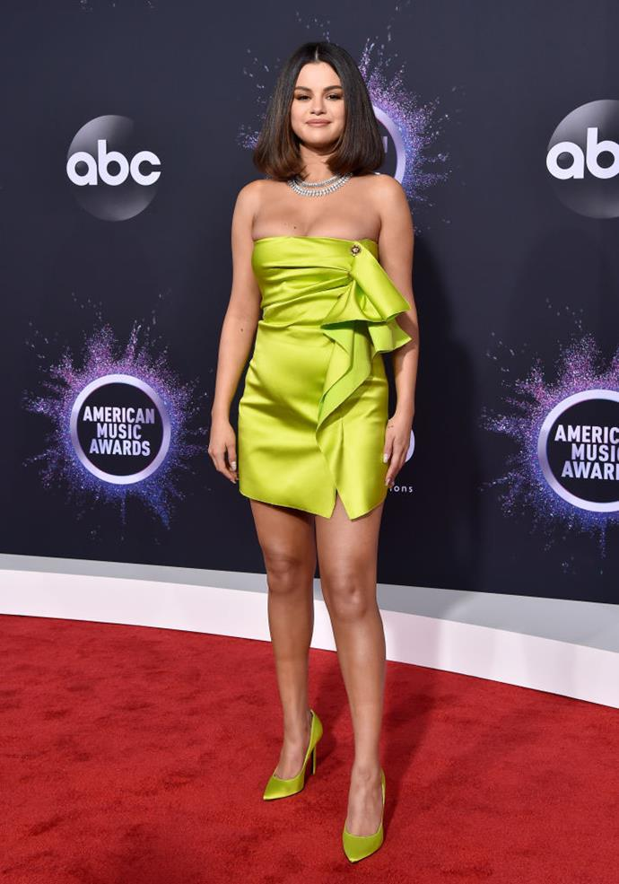 ***Selena Gomez: Now*** <br><br> As of 2019, Gomez has enlisted the help of celebrity superstylist Kate Young to attain an impressive, vibrant style aesthetic, seen here wearing off-the-runway Versace at the 2019 American Music Awards.