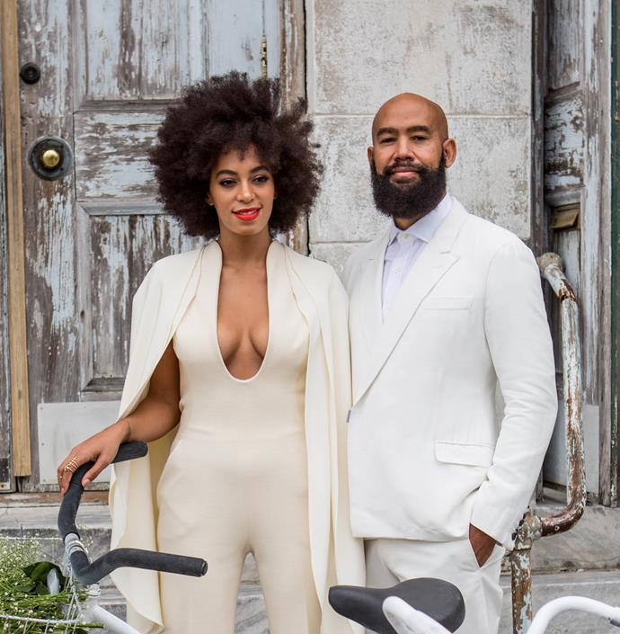 """**Solange Knowles' stunning natural afro**<br><br>  Singer Solange Knowles' simple afro from her 2014 wedding was a groundbreaking bridal hairstyle on multiple levels. While it was and arguably still is rare for any woman to choose not to have her locks styled for her big day, Knowles' decision to leave her hair undone gave rise to the important [natural hair movement](https://www.bbc.com/news/uk-england-39195836