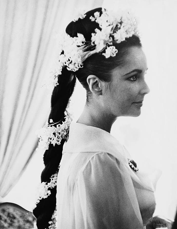 **Elizabeth Taylor's flower-adorned twisted high ponytail**<br><br>  Bold, unexpected and elegant in equal measure, Elizabeth Taylor's towering, twisted braid with floral adornment at her 1964 wedding to Richard Burton took bridal style to new heights.