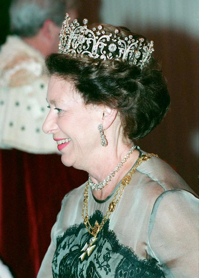 **The tiara:** The Poltimore Tiara.<br><br> **The wearer:** Princess Margaret, Countess of Snowdon.<br><br> **The details:** Princess Margaret bought this tiara from an auction in 1959. It is made of scrolls and diamond clusters. <br><br>